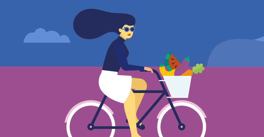 woman on bike with basket full of fruit and vegetables